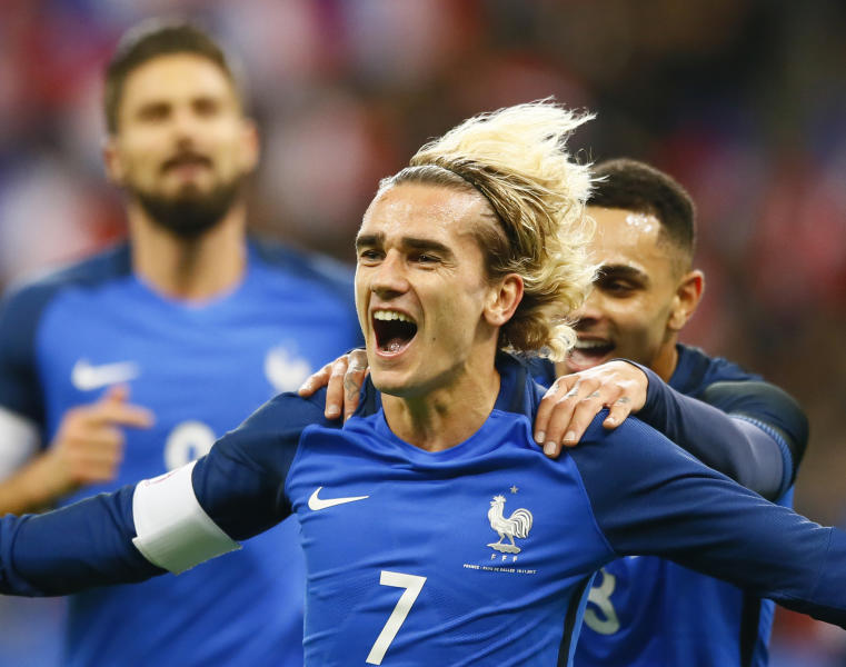 France's Antoine Griezmann celebrates after scoring his side's opening goal during an international friendly soccer match between France and Wales at Stade de France in Saint Denis, a northern suburb of Paris, France, Friday, Nov. 10, 2017. (AP Photo/Francois Mori)