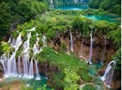 """<p>There's a reason Croatia is such a hotbed for tourism these days. It's <a href=""""https://www.purewow.com/travel/10-Insanely-Gorgeous-Under-the-Radar-European-Destinations"""" rel=""""nofollow noopener"""" target=""""_blank"""" data-ylk=""""slk:drop-dead gorgeous"""" class=""""link rapid-noclick-resp"""">drop-dead gorgeous</a>. Just look at this national park, complete with cascading waterfalls, cerulean lakes, hiking trails and limestone canyons.</p>"""