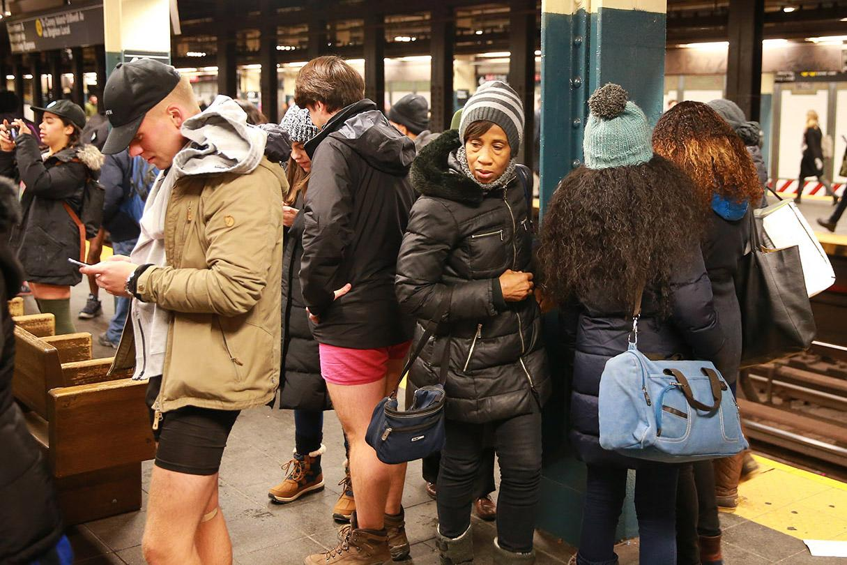 <p>A passengers checks out a participant in the No Pants Subway Ride in New York City on Jan. 8. The No Pants Subway Ride began in 2002 in New York as a stunt and has taken place in cities around the world since then. (Gordon Donovan/Yahoo News) </p>