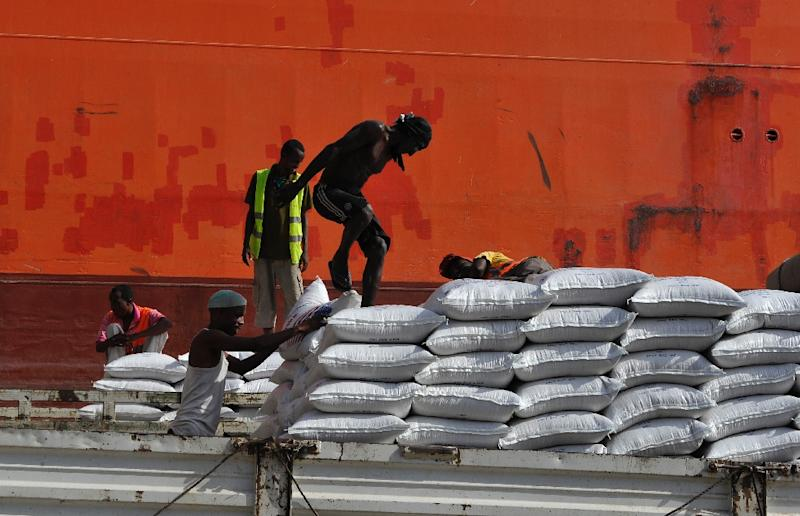 Casual labourers load goods in the port of Djibouti where unemployment is high at some 60 percent, and almost a quarter of the people live in poverty (AFP Photo/)