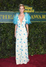 <p>Poppy bravely chose one of Prada's more stand-out gowns featuring lots of blue feathers. <i>[Photo: Getty]</i> </p>
