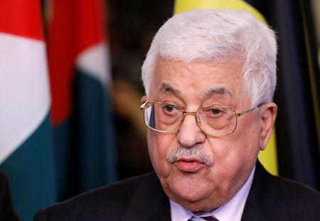 Palestinian President Mahmoud Abbas addresses reporters after a meeting with Belgian Prime Minister Charles Michel in Brussels