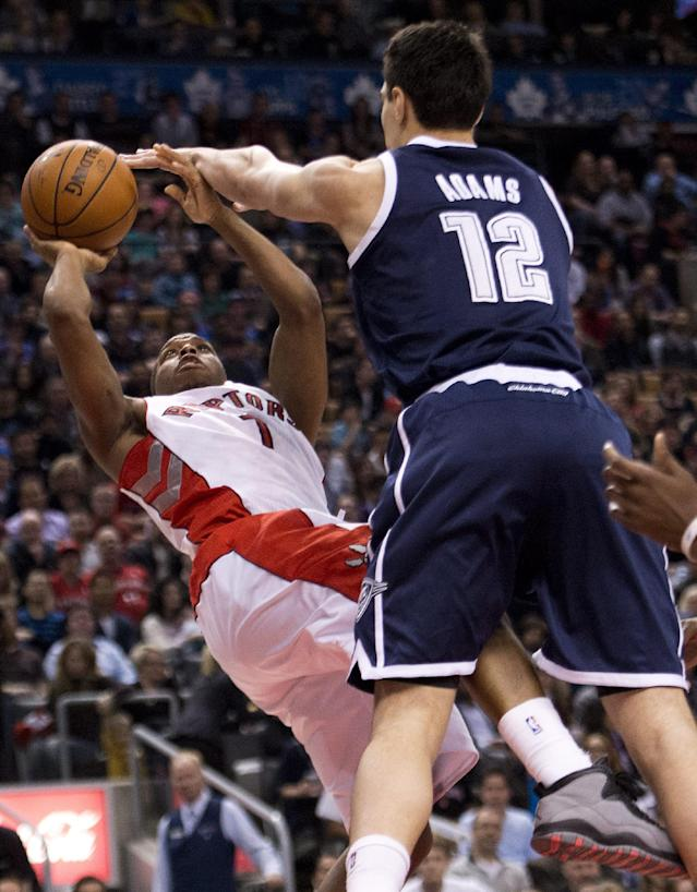 Toronto Raptors guard Kyle Lowry shoots as Oklahoma Thunder forward Steven Adams defends during the first half of an NBA basketball game in Toronto on Friday, March 21, 2014. (AP Photo/The Canadian Press, Nathan Denette)