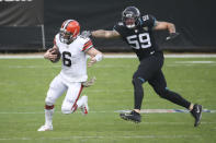 Cleveland Browns quarterback Baker Mayfield (6) tries to avoid a sack by Jacksonville Jaguars defensive end Aaron Lynch (59) during the first half of an NFL football game, Sunday, Nov. 29, 2020, in Jacksonville, Fla. (AP Photo/Stephen B. Morton)