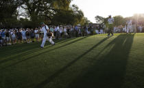 <p>Tiger Woods, third right, walks down the first fairway during a practice round for the Masters golf tournament in Augusta, Ga., Monday, April 5, 2010. The tournament begins Thursday, April, 8. (AP Photo/David J. Phillip) </p>