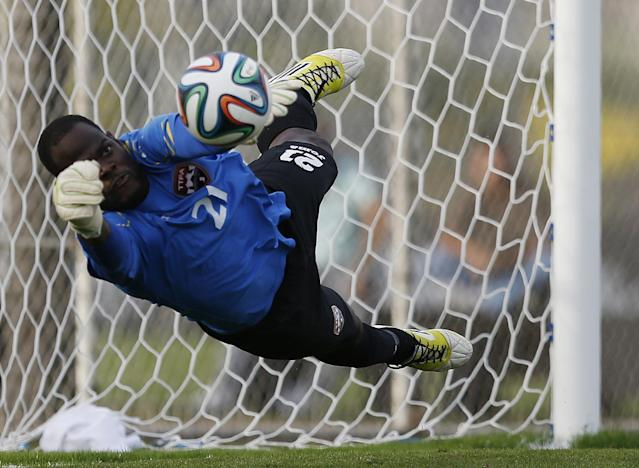 Trinidad and Tobago goalkeeper Jan Michael Williams makes a save on a penalty shot by Iran's Javad Nekounam during the second half of an international soccer friendly at the Corinthians soccer team training center Sao Paulo, Brazil, on Sunday, June 8, 2014. Iran will play in group F of the 2014 soccer World Cup. (AP Photo/Julio Cortez)