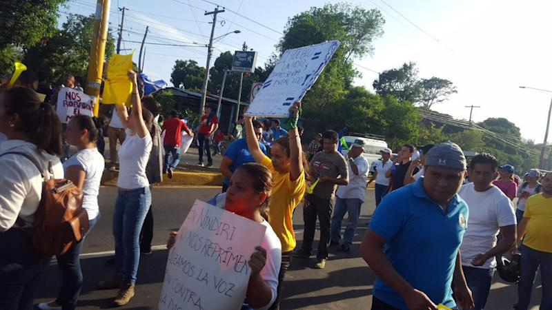 Demonstrators chant against social security cuts in Masaya, in western Nicaragua.