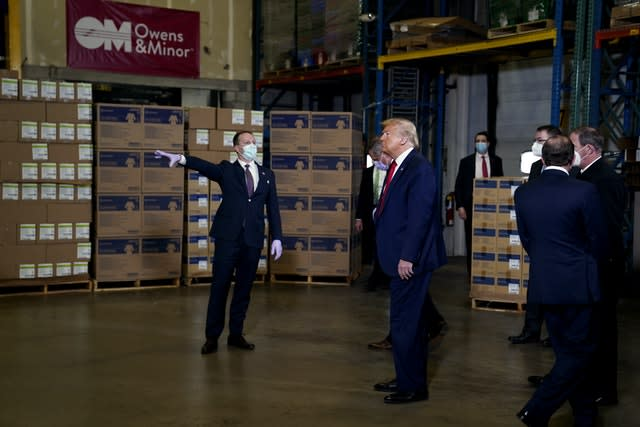Donald Trump, again ignoring recommendations to wear a face mask, tours Owens & Minor Inc., a medical supply company in Allentown, Pennsylvania (Evan Vucci/AP)