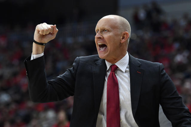 """FILE - In this Dec. 6, 2019, file photo, Louisville head coach Chris Mack reacts to a play during the first half of an NCAA college basketball game in Louisville, Ky. Louisville has received a notice of allegations from the NCAA, Monday, May 4, 2020, that accuses the mens basketball program of committing a Level I violation with an improper recruiting offer and extra benefits and several Level II violations that accuse former Cardinals coach Rick Pitino of failing to promote an atmosphere of compliance. """"While I understand the allegations brought today, I am confident that the University will do what is right, which includes fighting back on those charges that we simply do not agree with, and for which the facts do not substantiate,"""" Mack said in a statement. (AP Photo/Timothy D. Easley, File)"""