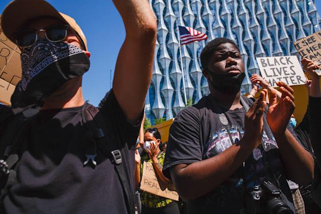 Activists chanting slogans at the US embassy during a George Floyd demonstration in London. (PA)