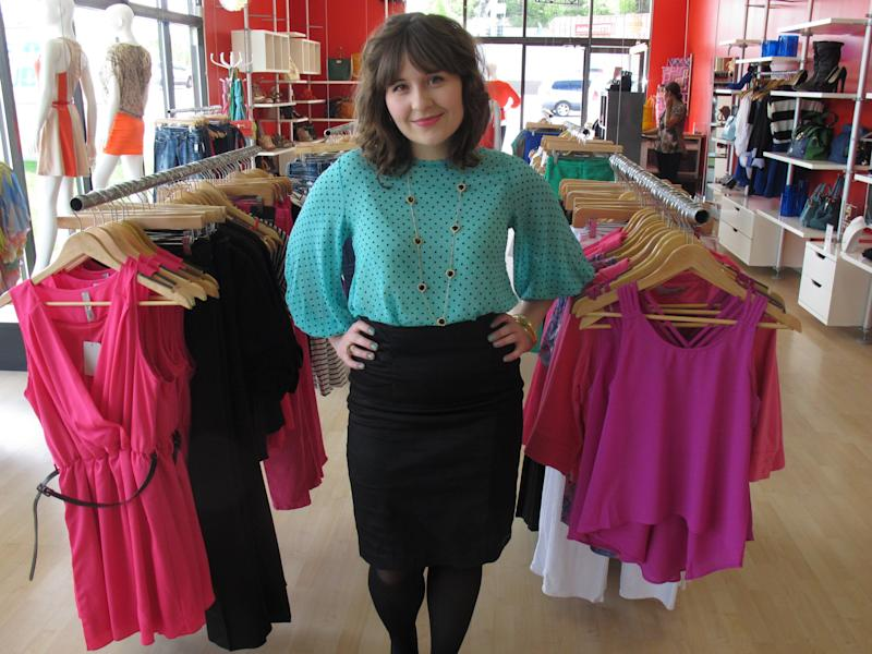 """In this photo taken Thursday, May 31, 2012, in Anchorage, Alaska, Hillary Walker, the assistant manager at lulu e. bebe fashion boutique in Anchorage. Travel and Leisure poll readers have named Anchorage residents as the nation's worst-dressed. Walker finds the poll """"a little ridiculous."""" (AP Photo/Mark Thiessen)"""