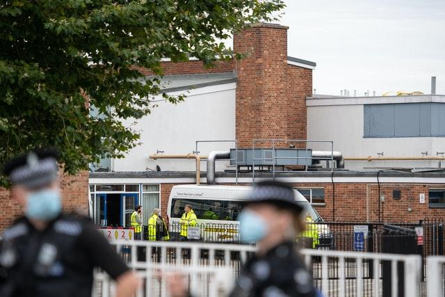 Police officers outside Kesgrave High School
