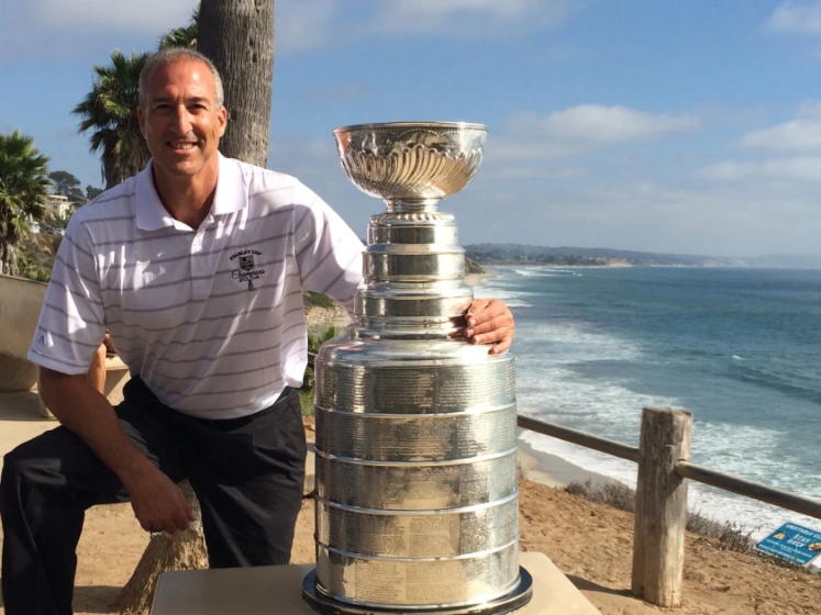 Jeff Solomon poses with the Stanley Cup