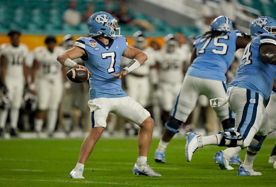MIAMI GARDENS, FLORIDA - JANUARY 02: Sam Howell #7 of the North Carolina Tar Heels looks to pass against the Texas A&M Aggies during the first half of the Capital One Orange Bowl at Hard Rock Stadium on January 02, 2021 in Miami Gardens, Florida. (Photo by Mark Brown/Getty Images)