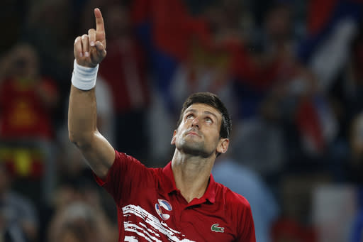 Novak Djovovic of Serbia reacts after winning the match against Rafael Nadal of Spain during their ATP Cup tennis match in Sydney, Sunday, Jan. 12, 2020. (AP Photo/Steve Christo)