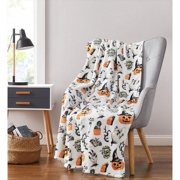 <p>The fabric on the <span>Ghosts and Frankensteins Oversized Halloween Accent Throw Blanket</span> ($25, originally $40) is hypoallergenic so that everyone can safely enjoy snuggling up with it. </p>