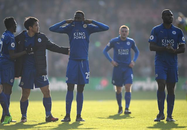 <p>Leicester players looking disheartened after the heavy defeat in Southampton </p>