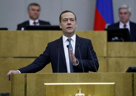 Russian Prime Minister Dmitry Medvedev delivers a speech during a session at the State Duma, the lower house of parliament, in Moscow