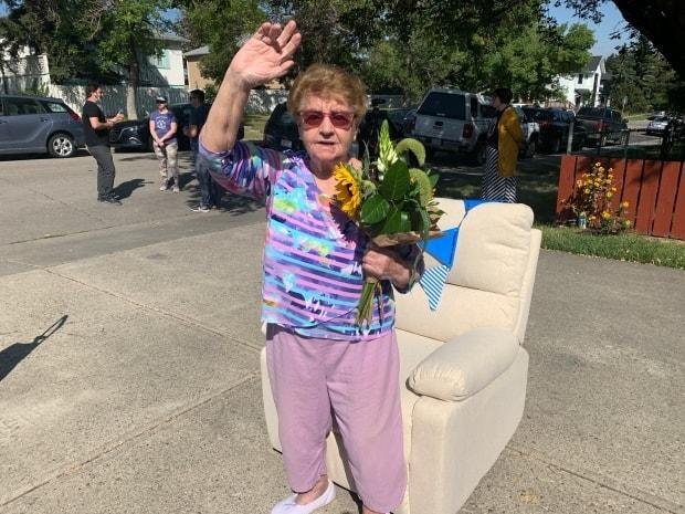 Helen Jusic, 85, captured her neighbours' hearts by simply standing on the street corner, waving and greeting them nearly every day during the spring and summer. On Sunday, Bridgeland neighbours gave back with a new recliner to rest her feet. (CBC/Elise Stolte - image credit)
