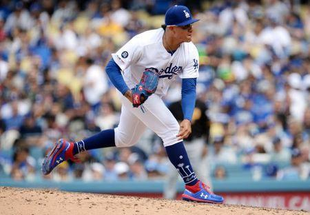 April 28, 2019; Los Angeles, CA, USA; Los Angeles Dodgers relief pitcher Julio Urias (7) throws against the Pittsburgh Pirates during the seventh inning at Dodger Stadium. Mandatory Credit: Gary A. Vasquez-USA TODAY Sports