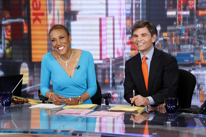 "This image released by ABC shows anchor Robin Roberts, left, and George Stephanopoulos during a broadcast of ""Good Morning America,"" Wednesday, Feb. 20, 2013 in New York. Roberts returned to the popular morning program after undergoing a bone marrow transplant five months ago. (AP Photo/ABC, Heidi Gutman)"