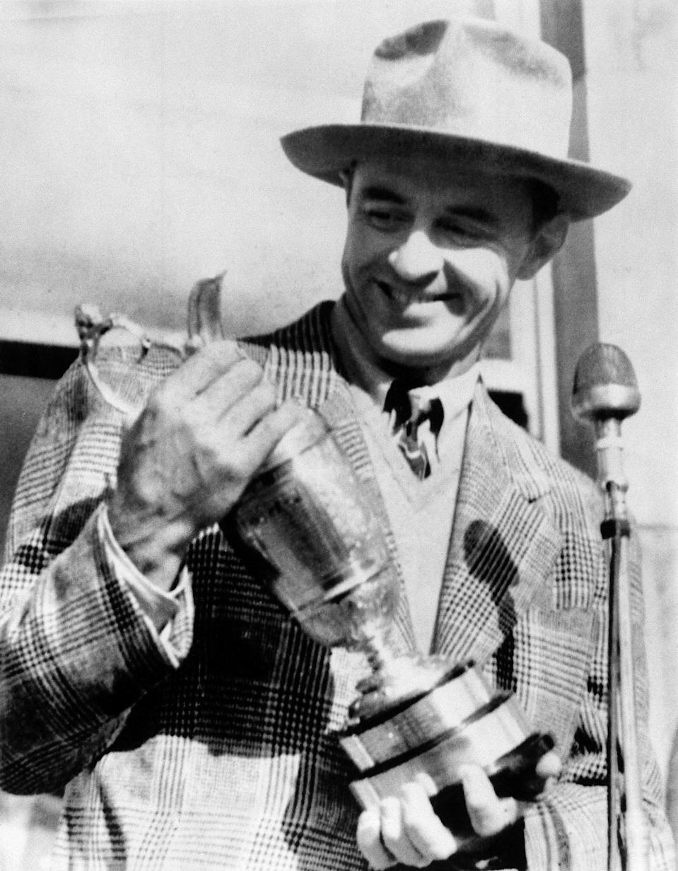FILE - In this July 5, 1946, file photo, Sam Snead, holds the British Open Golf Championship Trophy he won at St. Andrews, Scotland with a 72-hole score of 290. Snead, who won 75 years ago, did not return to the British Open until 1962. (AP Photo/File)