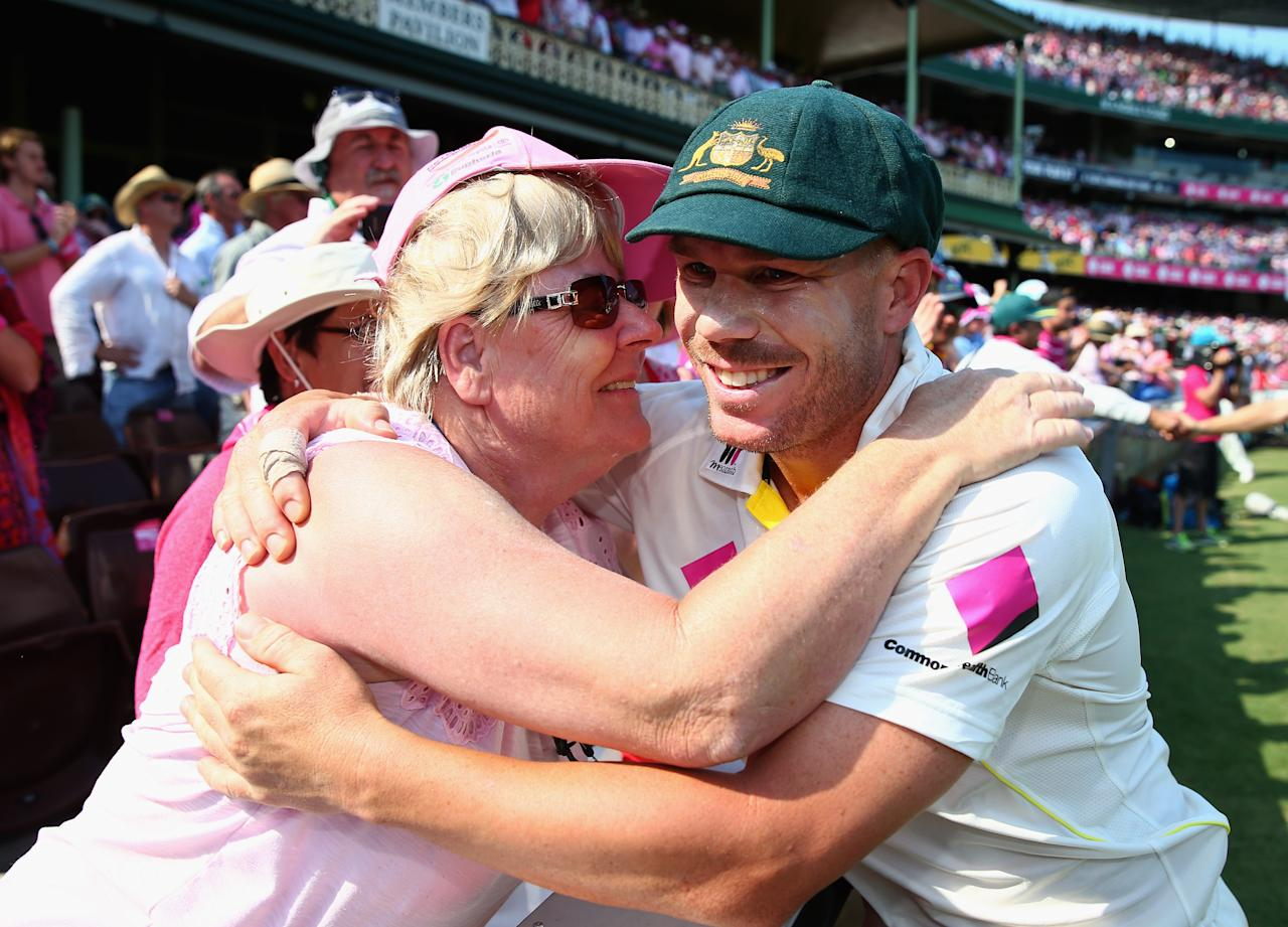 SYDNEY, AUSTRALIA - JANUARY 05:  David Warner of Australia celebrates victory with his mother Lorraine Warner during day three of the Fifth Ashes Test match between Australia and England at Sydney Cricket Ground on January 5, 2014 in Sydney, Australia.  (Photo by Ryan Pierse/Getty Images)