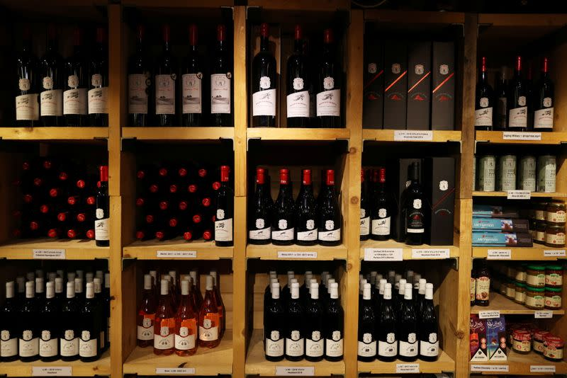 Shelves stacked with wine bottles are seen at a visitor's centre at Tura Winery in Rehelim, an Israeli settlement in the occupied-West Bank