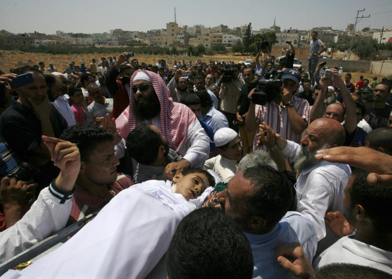 People carry the body of 6-year-old Syrian boy Bilal El-Lababidi during his funeral in Ramtha, Jordan, Friday, July 27, 2012. The boy was shot dead by Syrian border guards as his parents and around a dozen other Syrians tried to cross the border to seek refuge in Jordan, his mother said. (AP Photo/Mohammad Hannon)