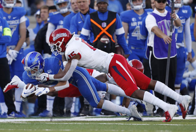 Fresno State linebacker Arron Mosby, right, tackles Air Force running back Kadin Remsberg after a short gain in the first half of an NCAA college football game Saturday, Oct. 12, 2019, at Air Force Academy, Colo. (AP Photo/David Zalubowski)
