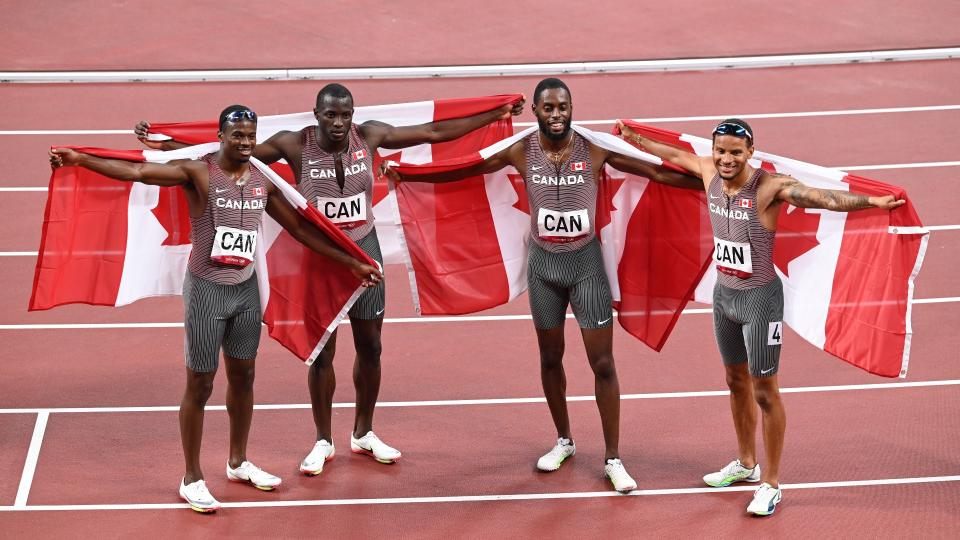 TOKYO, JAPAN - AUGUST 05: Aaron Brown, Jerome Blake, Brendon Rodney, and Andre De Grasse of team Canada celebrate after the men's 4x100m relay final during the Tokyo 2020 Olympic Games at Olympic Stadium in Tokyo, Japan on August 06, 2021. (Photo by Mustafa Yalcin/Anadolu Agency via Getty Images)
