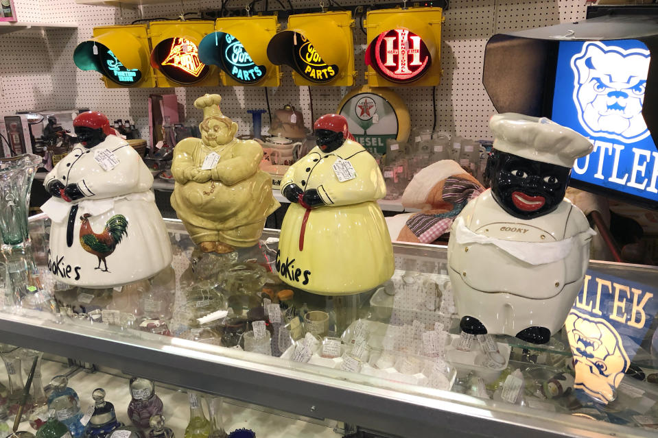 Coin banks featuring Black men and women with exaggerated features are for sale at Exit 76 Antique Mall in Edinburgh, Indiana, Tuesday, July 21, 2020. U.S. Rep. Greg Pence, the older brother Vice President Mike Pence, is being criticized for allowing the sale of objects with racist depictions of African Americans at the mall the congressman owns with his wife. (AP Photo/Casey Smith)