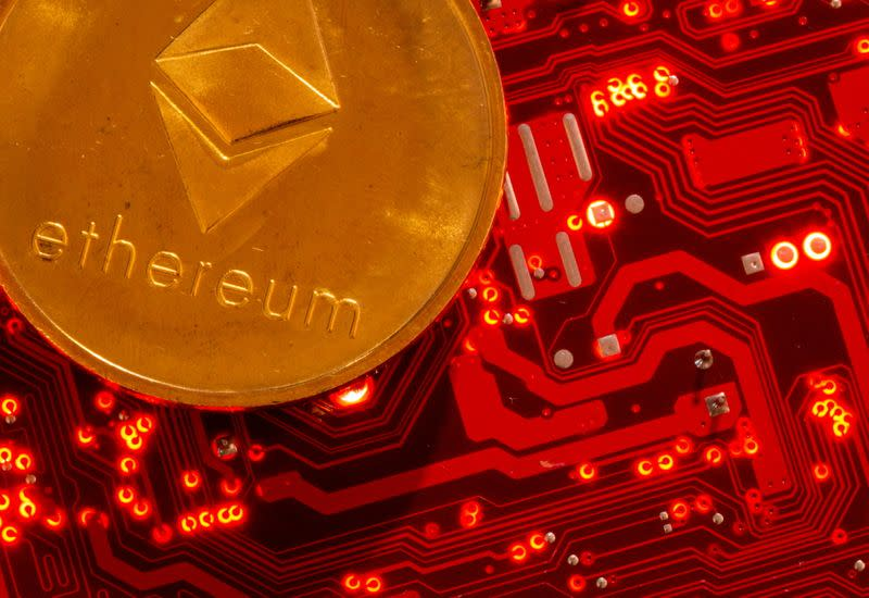 FILE PHOTO: Representation of cryptocurrency Ethereum is placed on PC motherboard in this illustration taken