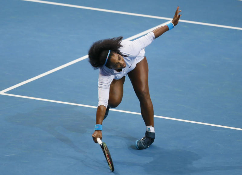 File-This Dec. 7, 2015, file photo shows USA's Serena Williams tripping as she returns a shot to Croatia's Mirjana Lucic-Baroni of Japan Warriors in the women's singles match of the 2015 International Premier Tennis League at suburban Pasay city south of Manila, Philippines. Williams has been voted the AP Female Athlete of the Decade for 2010 to 2019. Williams won 12 of her professional-era record 23 Grand Slam singles titles over the past 10 years. No other woman won more than three in that span. She also tied a record for most consecutive weeks ranked No. 1 and collected a tour-leading 37 titles in all during the decade. Gymnast Simone Biles finished second in the vote by AP member sports editors and AP beat writers. Swimmer Katie Ledecky was third, followed by ski racers Lindsey Vonn and Mikaela Shiffrin. (AP Photo/Bullit Marquez, File)