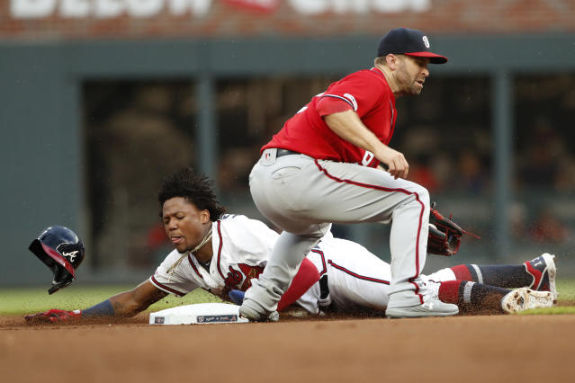 Atlanta Braves' Ronald Acuna Jr., left, steals second base as Washington Nationals second baseman Brian Dozier, right, handles the late throw in the first inning of a baseball game Saturday, July 20, 2019, in Atlanta. (AP Photo/John Bazemore)