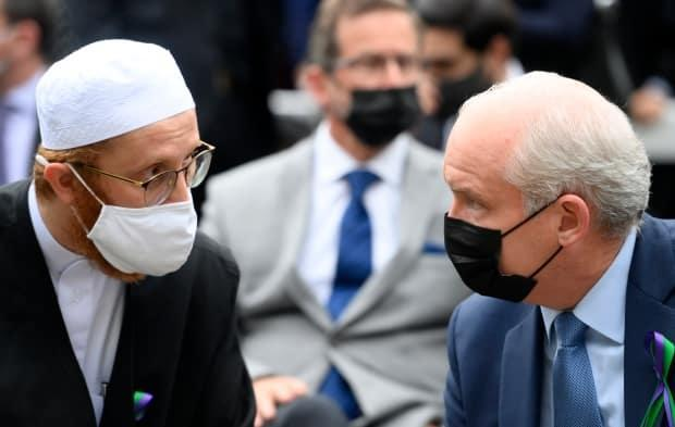 Conservative Leader Erin O'Toole, right, speaks with London Muslim Mosque imam Abd Alfatah Twakkal at a vigil for the victims of the deadly vehicle attack on five members of the Canadian Muslim community in London, Ont., on Tuesday, June 8, 2021. The party has little diverse representation in its Commons caucus after Monday's vote. (Nathan Denette/Canadian Press - image credit)