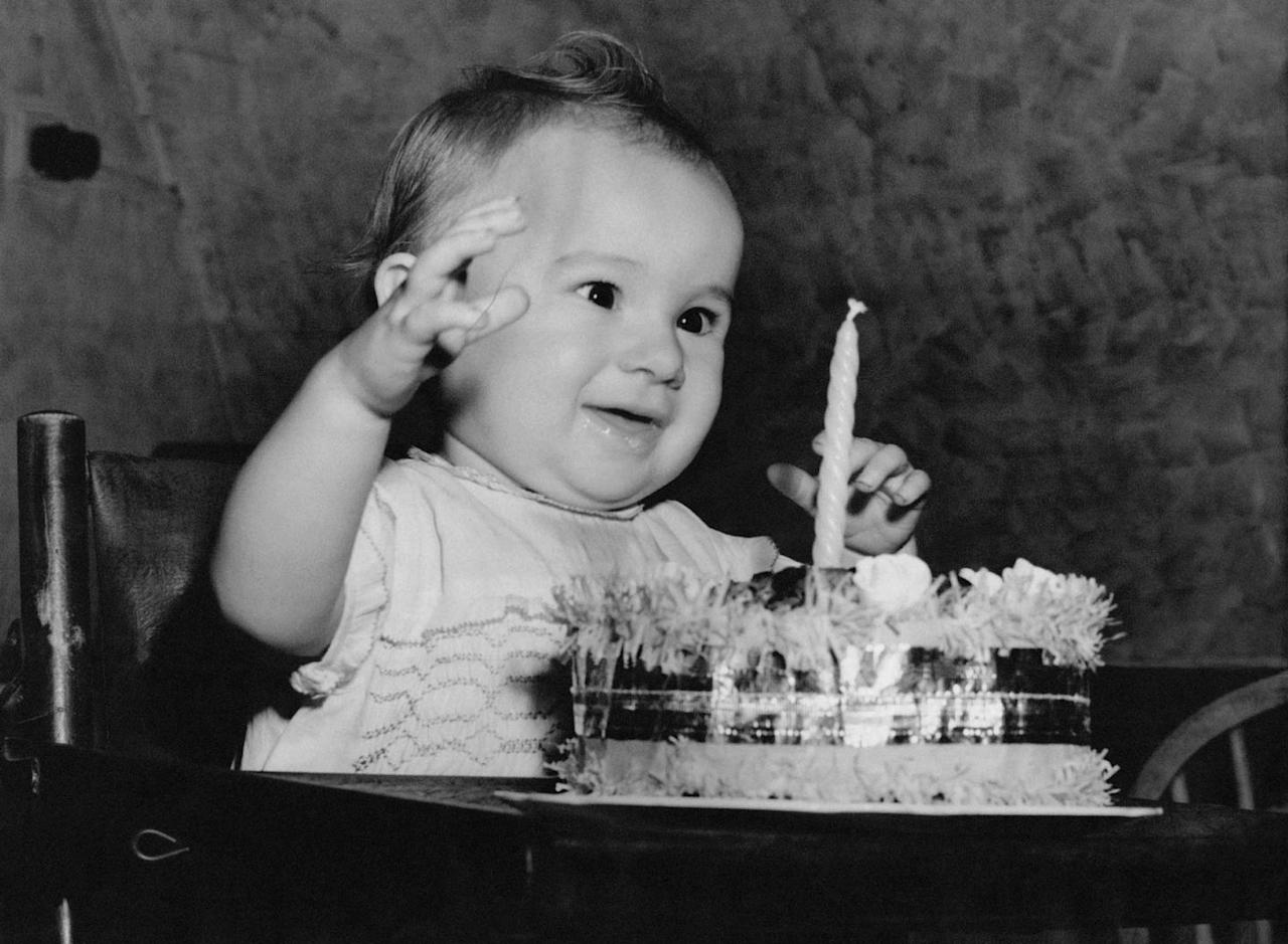 <p>Blowing out a candle on his birthday.</p>