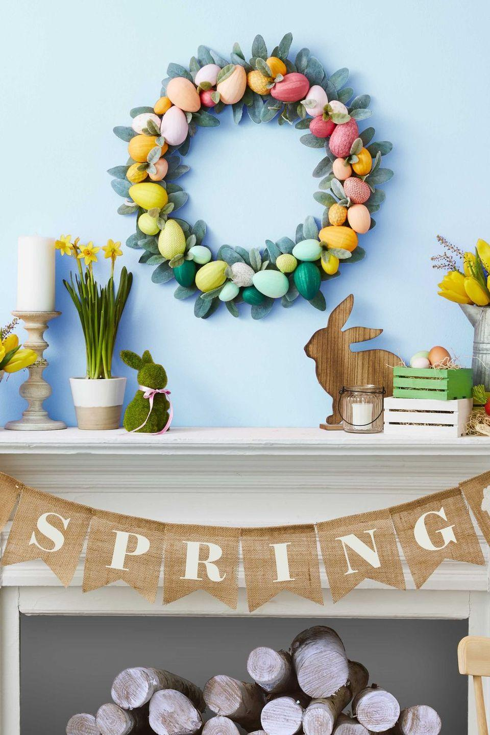 """<p>This rainbow Easter egg wreath is the perfect craft to use as decoration in your living room or to brighten up your front door. </p><p><strong><em><a href=""""https://www.womansday.com/home/crafts-projects/g2886/diy-easter-wreaths/?slide=6"""" rel=""""nofollow noopener"""" target=""""_blank"""" data-ylk=""""slk:Get the Easter Egg Wreath tutorial."""" class=""""link rapid-noclick-resp"""">Get the Easter Egg Wreath tutorial. </a></em></strong></p>"""