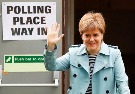 Scotland's first minister Nicola Sturgeon arrives to vote in local elections at a polling station in Glasgow