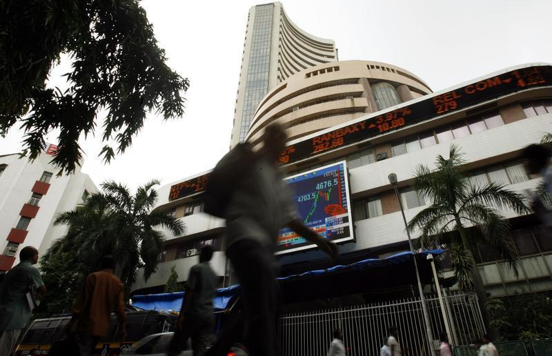 People walk pass the Bombay Stock Exchange building in Mumbai