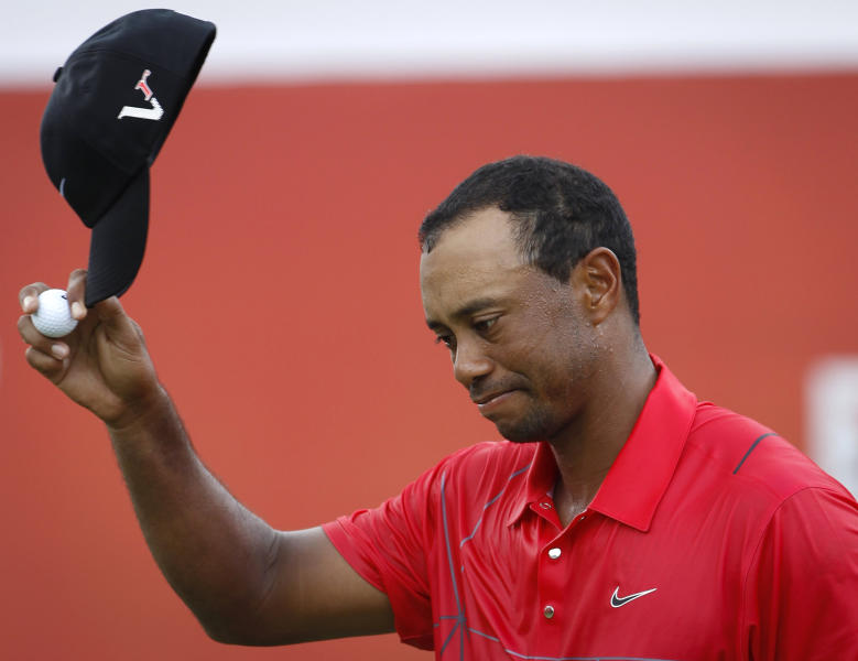 Tiger Woods of the United States greets the crowd on the 18th hole after he completed the final round of the CIMB Classic golf tournament at the Mines Resort and Golf Club in Kuala Lumpur, Malaysia, Sunday, Oct. 28, 2012.  (AP Photo/Vincent Thian)