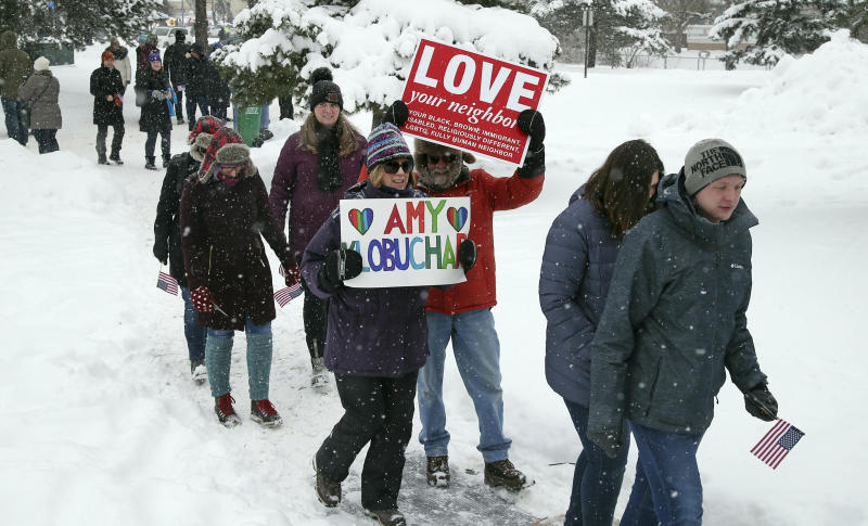 Snow falls Sunday as rallygoers arrive at Boom Island Park in Minneapolis for Democratic Sen. Amy Klobuchar's announcement that she plans to run for president. (ASSOCIATED PRESS)