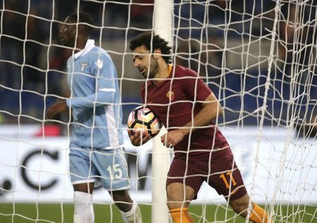 Football Soccer - AS Roma v Lazio - Italian Cup - Olympic Stadium, Rome, Italy - 4/04/17 AS Roma's Mohamed Salah celebrates after scoring third goal. REUTERS/Max Rossi