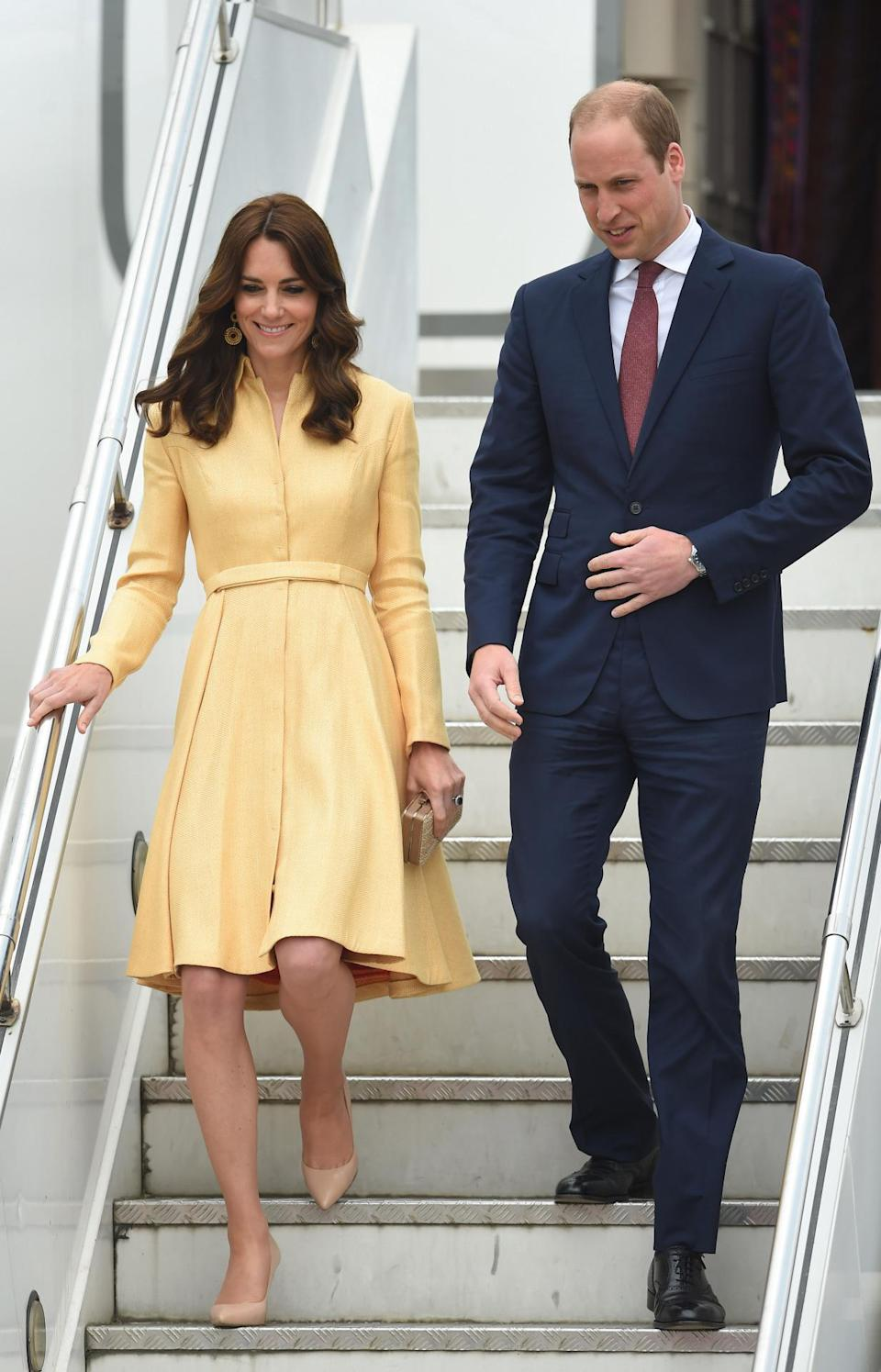 <p>For her arrival in Bhutan, Kate dressed in a yellow Emilia Wickstead coat dress accessorised with nude pumps and a matching clutch (again, both L.K. Bennett).</p><p><i>[Photo: PA]</i></p>