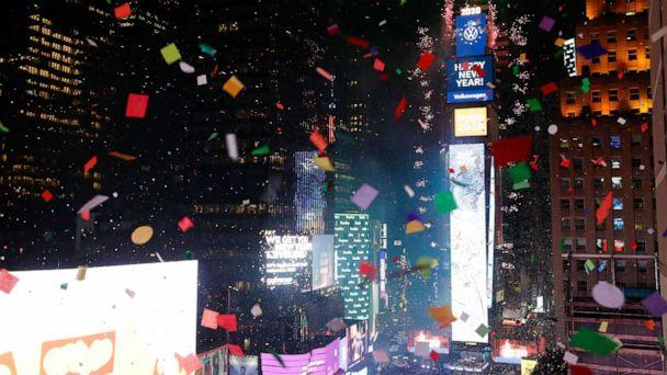 PHOTO: Confetti drops over the crowd as the clock strikes midnight during the New Year's celebration as seen from the New York Marriott Marquis in New York's Times Square, Wednesday, Jan. 1, 2020. (Frank Franklin Ii/AP)