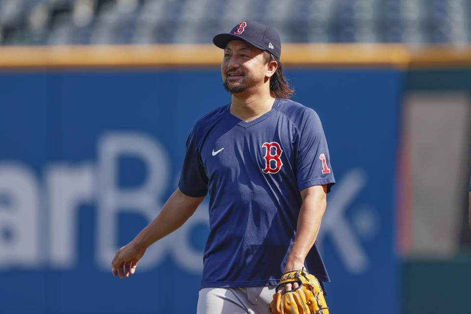 Boston Red Sox relief pitcher Hirokazu Sawamura walks off the field after warming up before a baseball game against the Cleveland Indians, Sunday, Aug. 29, 2021, in Cleveland. (AP Photo/Ron Schwane)