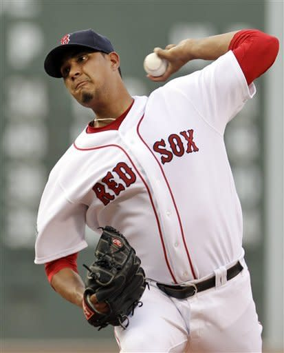 Boston Red Sox starting pitcher Felix Doubront delivers to the Miami Marlins during the first inning of an interleague baseball game at Fenway Park in Boston on Wednesday, June 20, 2012. (AP Photo/Elise Amendola)