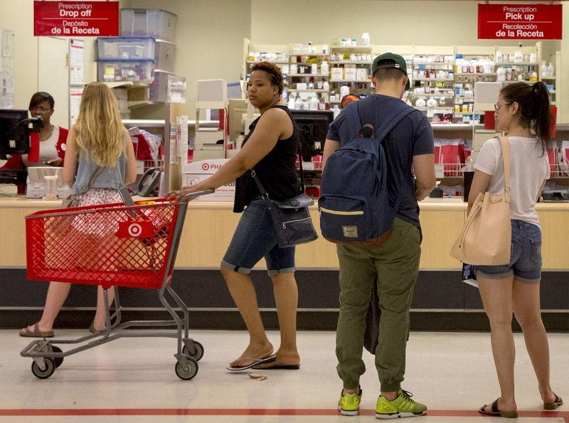 Customers shop in the pharmacy department of a Target store in the Brooklyn borough of New York