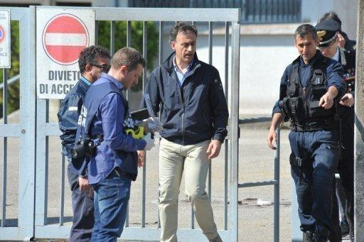 Police search the site of a blast near a school in Brindisi, Italy May 19. Police have arrested two suspects over the bombing that killed a 16-year-old girl and seriously injured five more teenagers