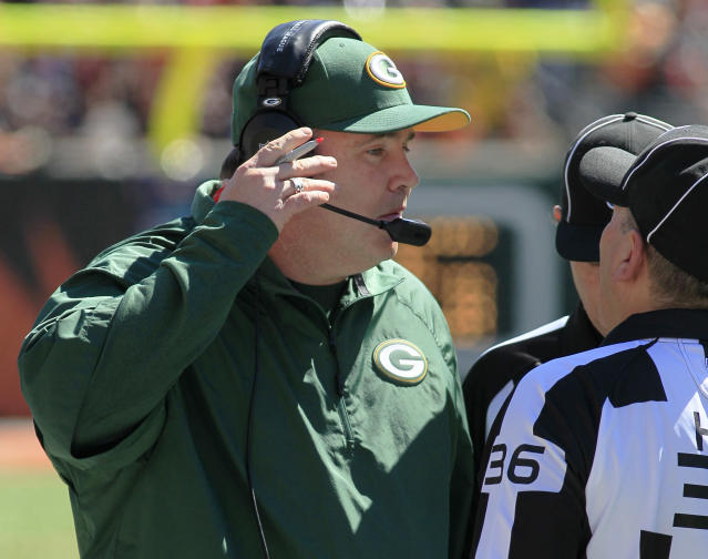 Green Bay Packers head coach Mike McCarthy talks with officials in the first half of an NFL football game against the Cincinnati Bengals, Sunday, Sept. 22, 2013, in Cincinnati. (AP Photo/Tom Uhlman)